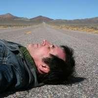 Man lying in road